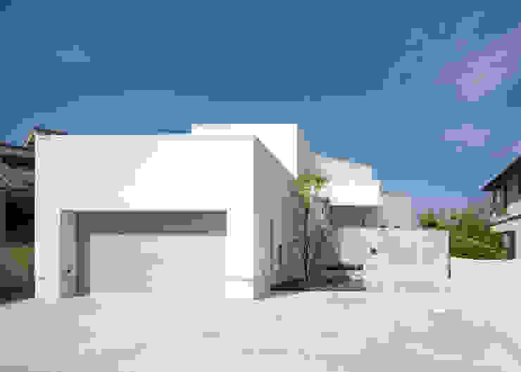 Casas estilo moderno: ideas, arquitectura e imágenes de 株式会社細川建築デザイン Moderno