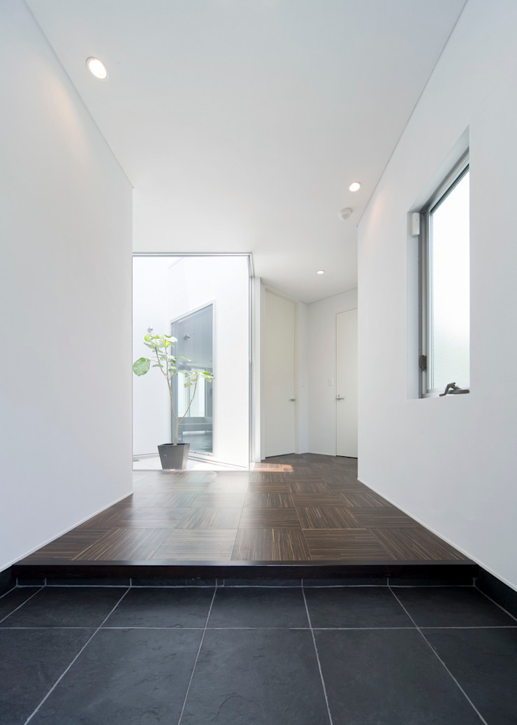株式会社細川建築デザイン Pareti & Pavimenti in stile moderno