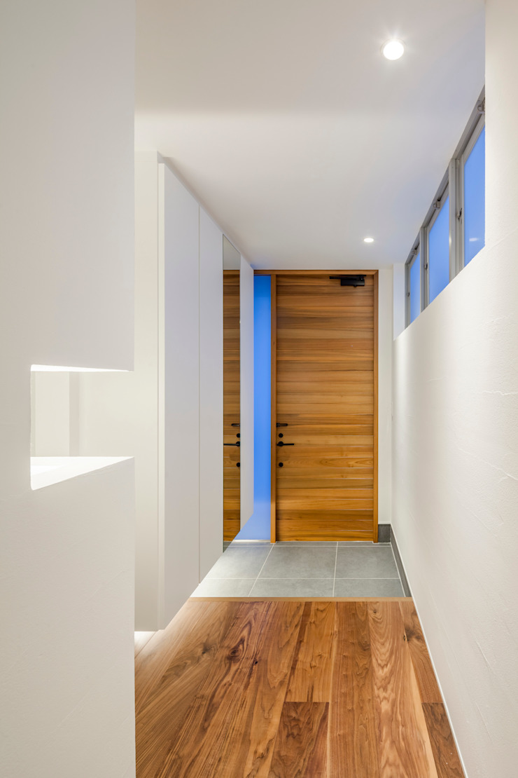 道後のコートハウス モダンな 壁&床 の 株式会社細川建築デザイン モダン