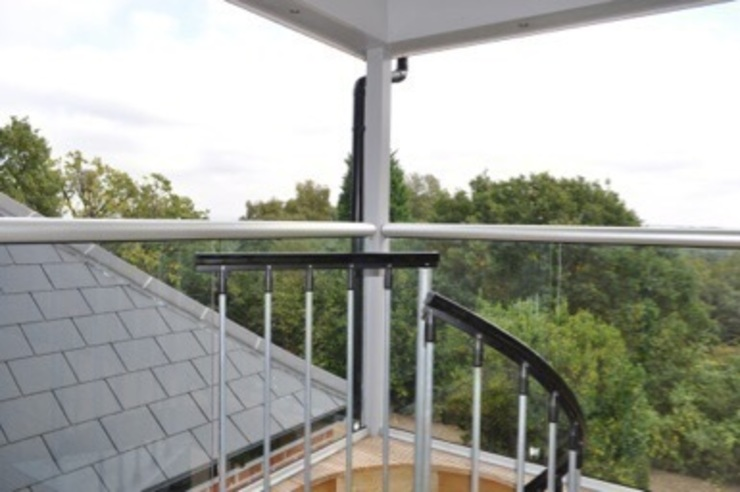 Camilia Cottage - External staircase to balcony from garden by Hampshire Design Consultancy Ltd.