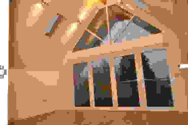 Camilia Cottage by Hampshire Design Consultancy Ltd.
