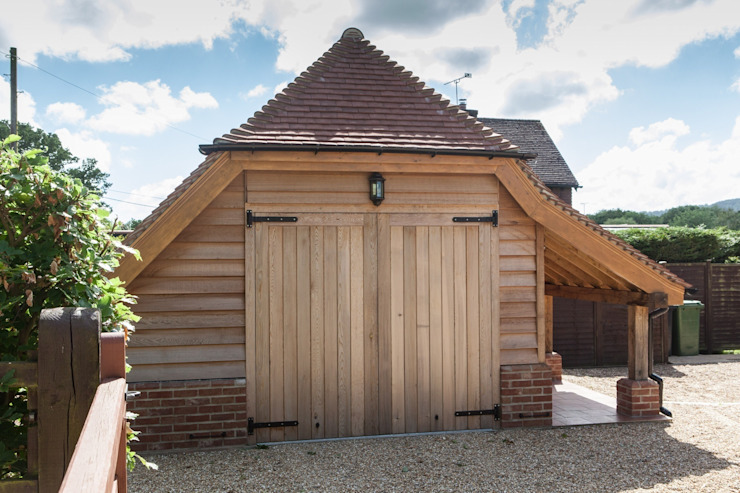 Meadowlands - new garage with additional storage by Hampshire Design Consultancy Ltd.