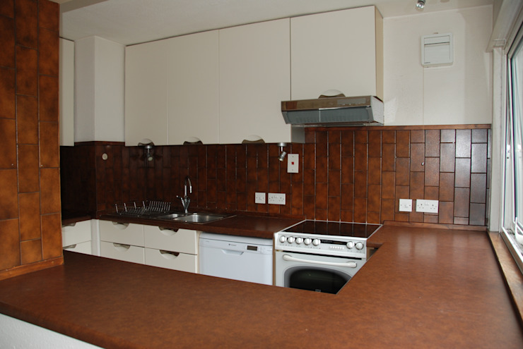 Before photo of cooker and oven:   by The Kitchen Makeover Shop Ltd,
