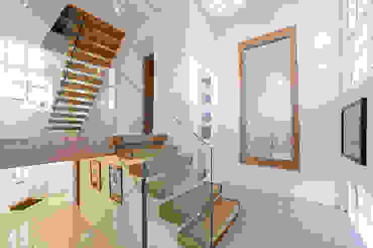 Tolmers Park Modern corridor, hallway & stairs by Nicolas Tye Architects Modern
