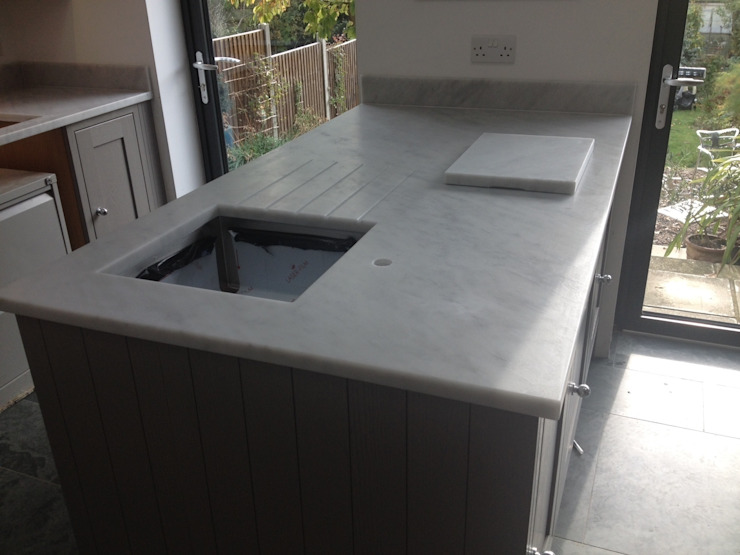 Honed Carrara Marble Worktops:  Kitchen by Marbles Ltd