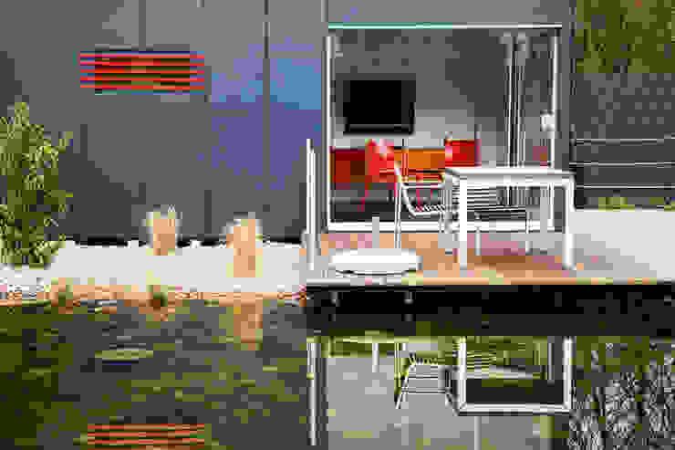 Jardins  por GarDomo Designgartenhäuser , Moderno