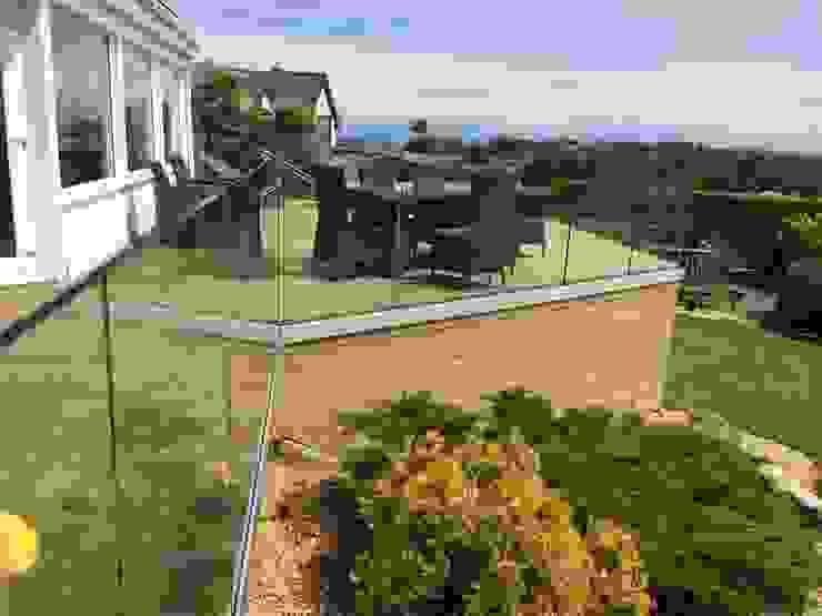 Infinity Glass Balcony North Wales Modern balcony, veranda & terrace by sally3 Modern