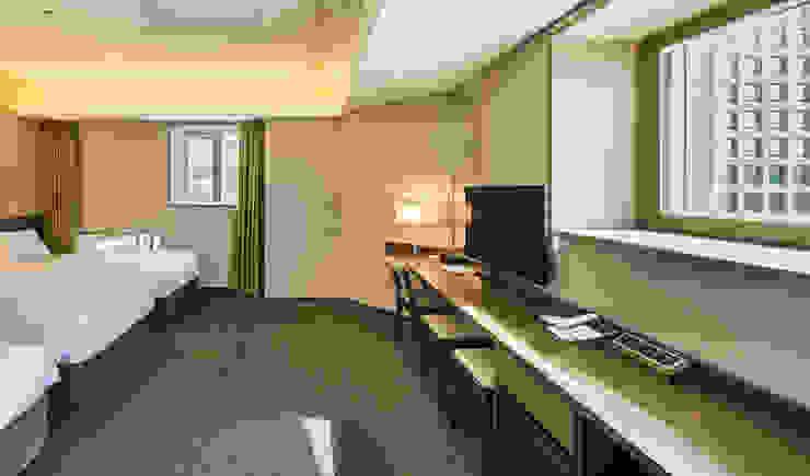 호텔마누: 유오에스건축사사무소(주)의  침실