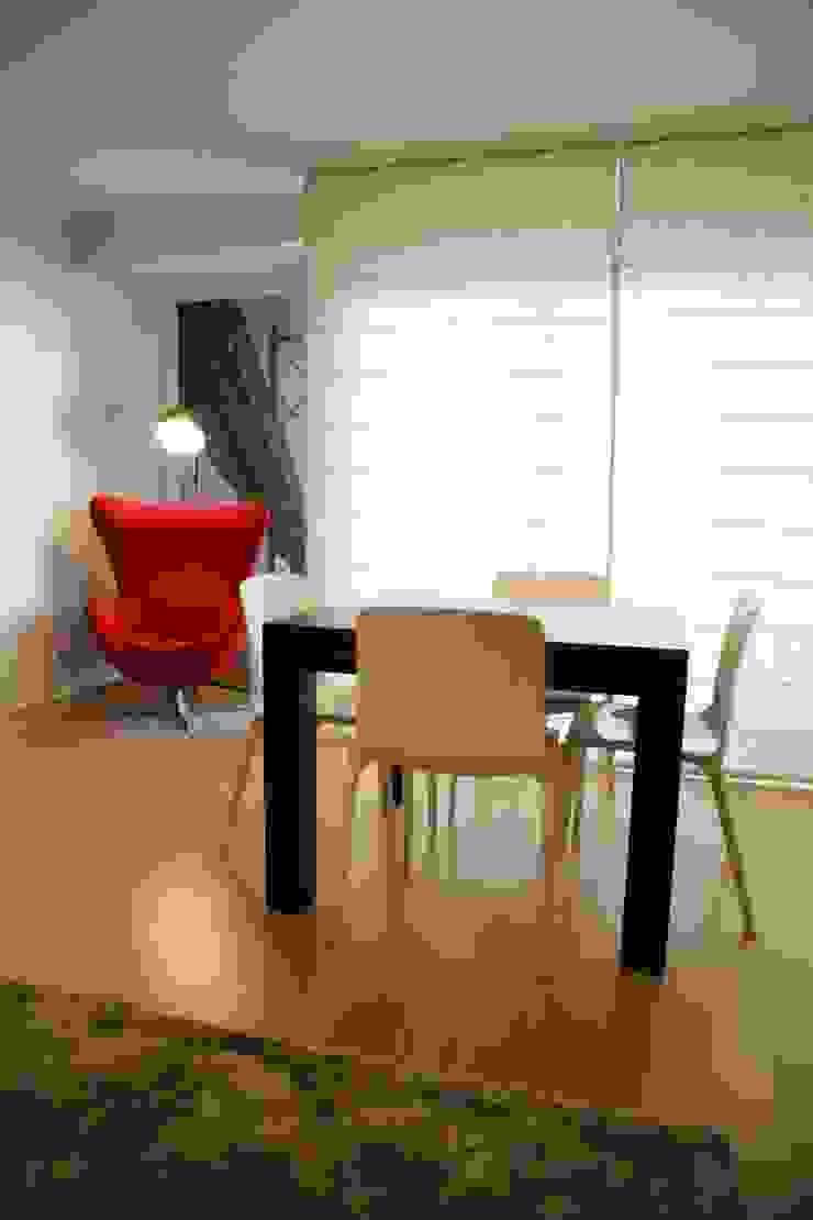 Sala Comum_Zona de refeições e leitura Salas de jantar modernas por Traço Magenta - Design de Interiores Moderno