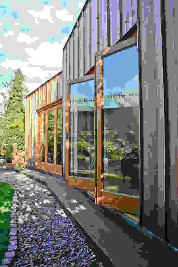 Bi-folding doors to rear elevation Modern houses by Neil Dusheiko Architects Modern