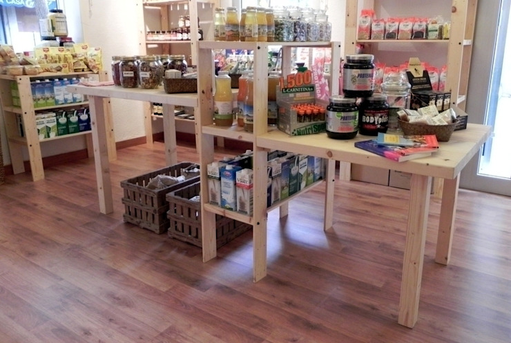 Mesa central con dos niveles Oficinas y tiendas de estilo minimalista de mobla manufactured architecture scp Minimalista