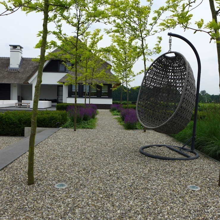Jardins modernos por Hendriks Hoveniers Moderno