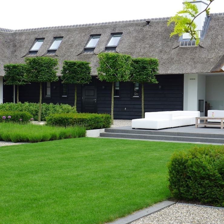 Landelijke Vila Moderne tuinen van Hendriks Hoveniers Modern