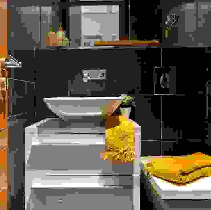 Black, yellow and white creates a stylish modern bathroom in a compact area. Modern bathroom by Design by Deborah Ltd Modern