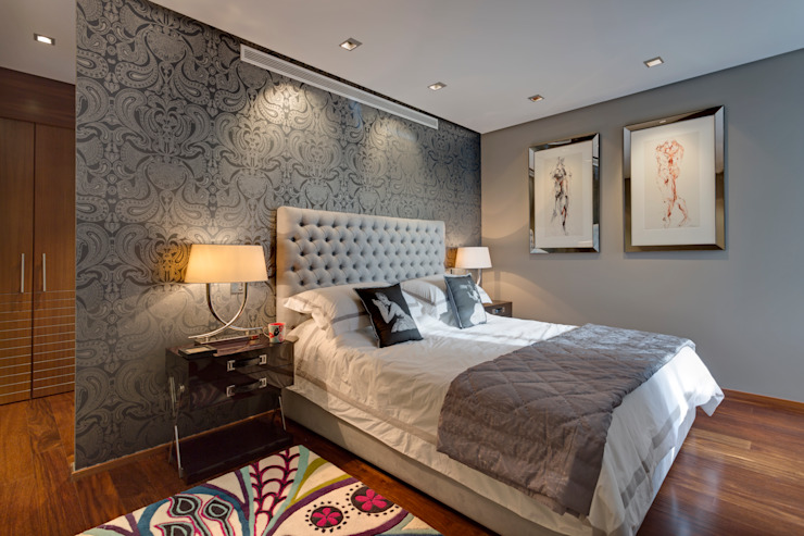 Stylish and sophisticated, a bedroom based on neutrals with a colourful bedside rug. Modern style bedroom by Design by Deborah Ltd Modern