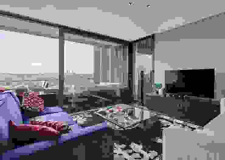 A comfortable family lounge overlooking the Madrid skyline. Modern living room by Design by Deborah Ltd Modern