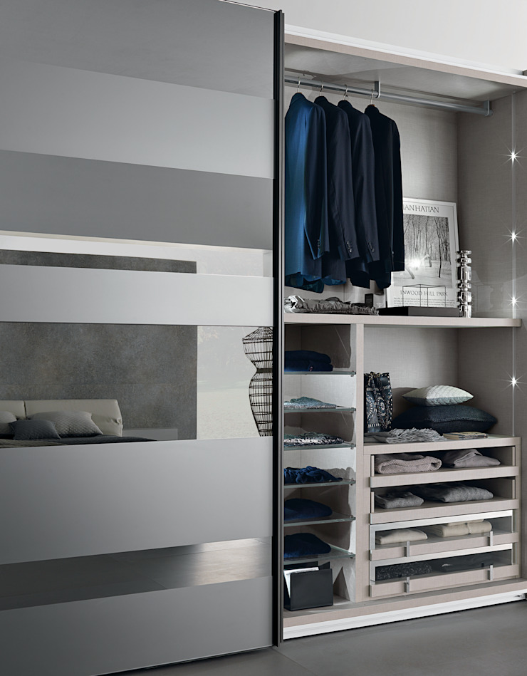 Interior shot of our high end wardrobes. Showing internal LED lighting and glass fronted drawers. Lamco Design LTD ChambrePenderies et commodes