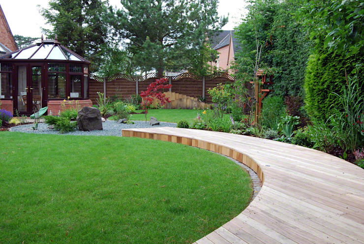 A curved deck links the seating area to the house Lush Garden Design Asian style garden