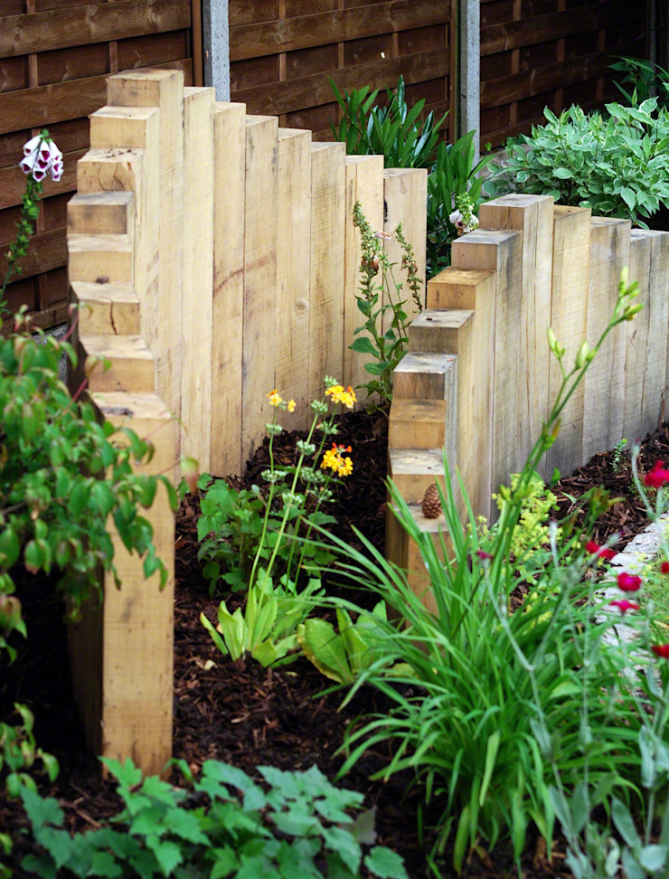 Sculptural inverted oak sleepers Lush Garden Design สวน