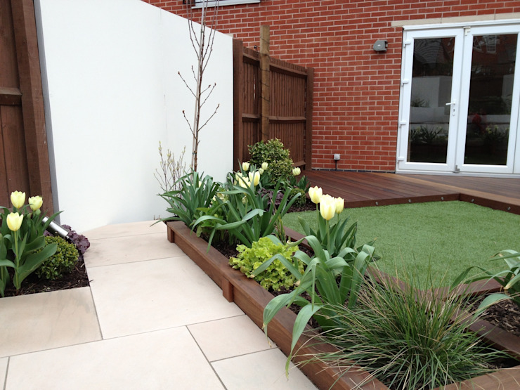 Hardwood planters and decking Modern style gardens by Lush Garden Design Modern