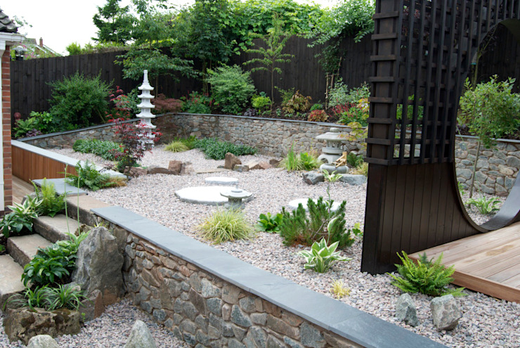 Granite clad retaining walls Asian style garden by Lush Garden Design Asian