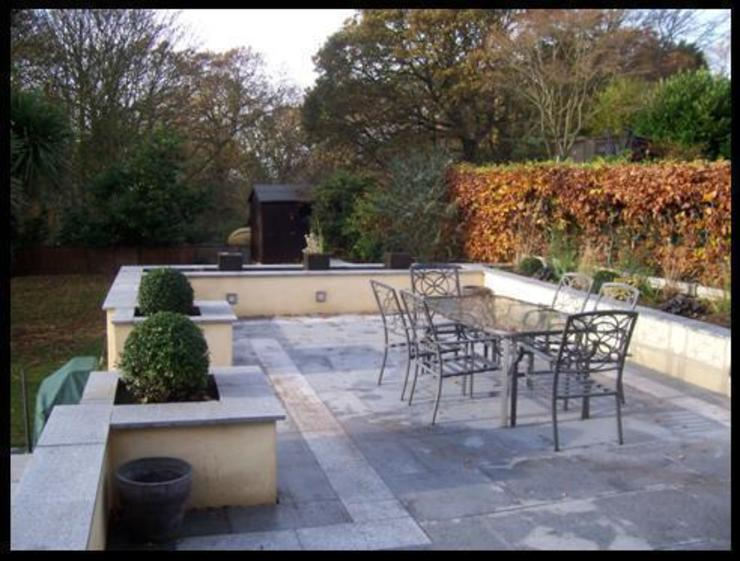 Granite paving by Westacott Gardens
