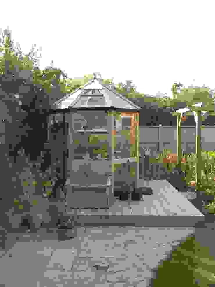 Smaller deck to surround new greenhouse. by Westacott Gardens