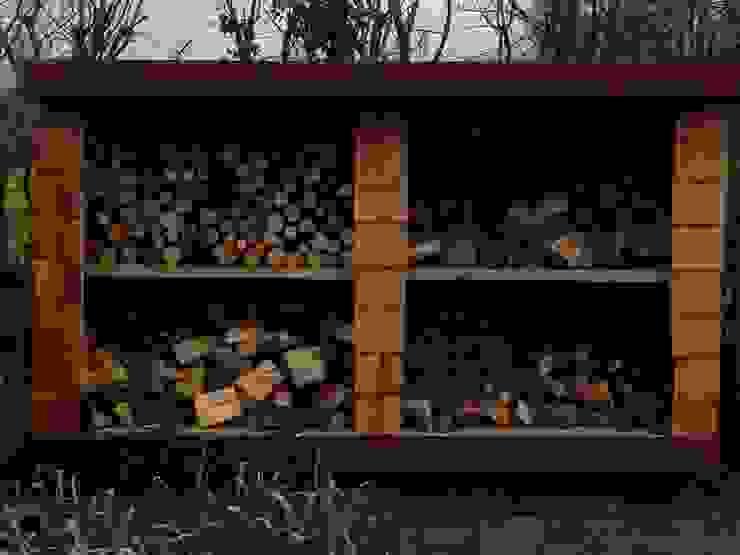 Bespoke woodstore built with utilising cedar shingles. by Westacott Gardens
