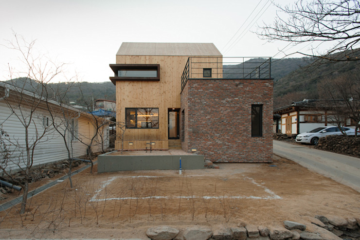 Modern houses by (주)오우재건축사사무소 OUJAE Architects Modern