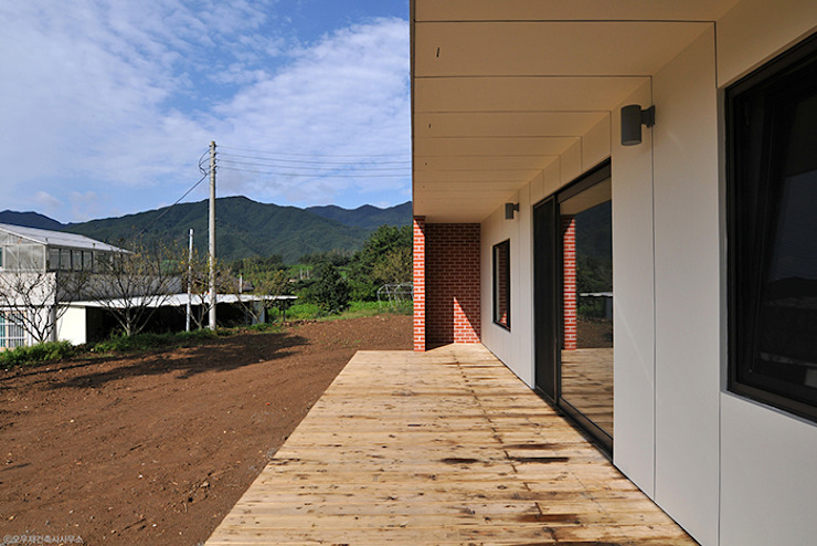 Casas de estilo  por (주)오우재건축사사무소 OUJAE Architects, Moderno
