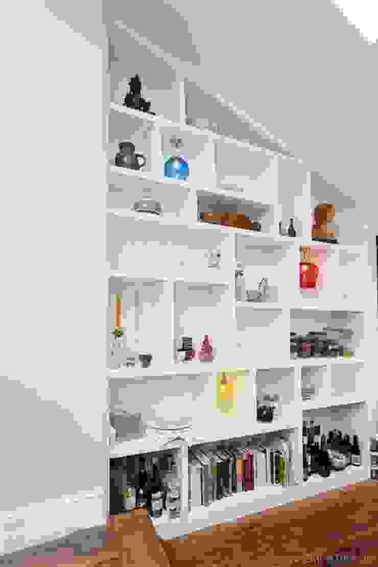 Bespoke shelving with random compartments.: minimalist  by Empatika, Minimalist