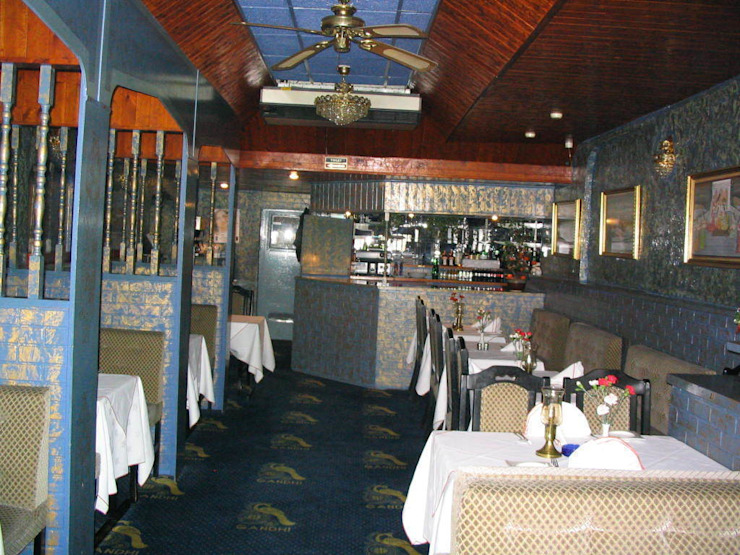 Gandhi Indian Restaurant by Martin Hall Design