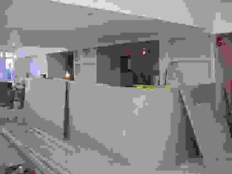 Construction of bar in Steak house restaurant. by Martin Hall Design
