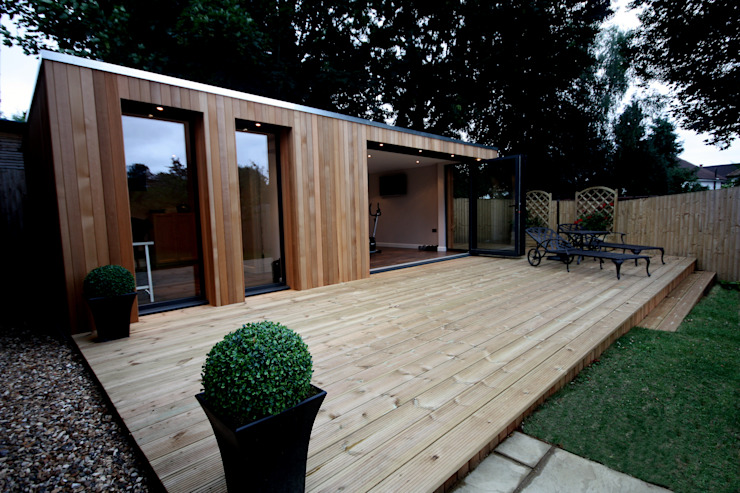 Stunning garden treatment room and gymnasium suite:  Garden by The Swift Organisation Ltd