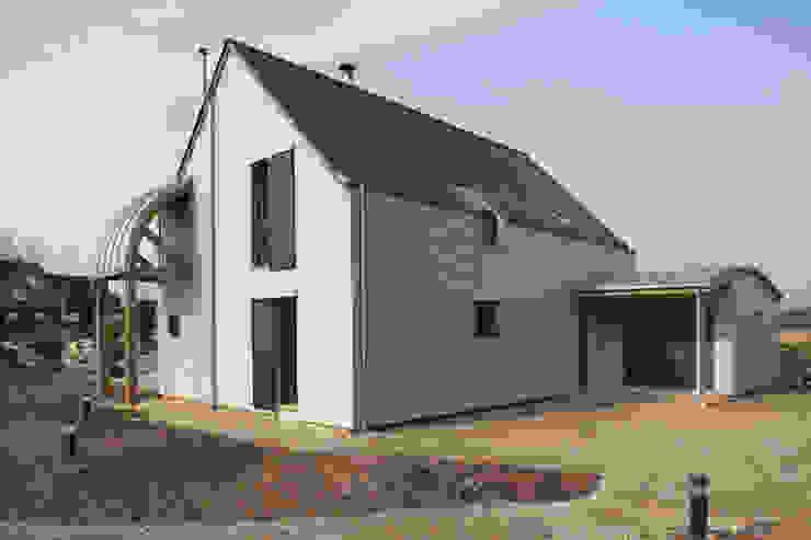 Façade nord & entrée maison Maisons modernes par Patrice Bideau a.typique Moderne