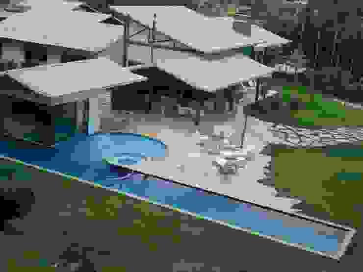 Residência TF Piscinas modernas por Mascarenhas Arquitetos Associados Moderno