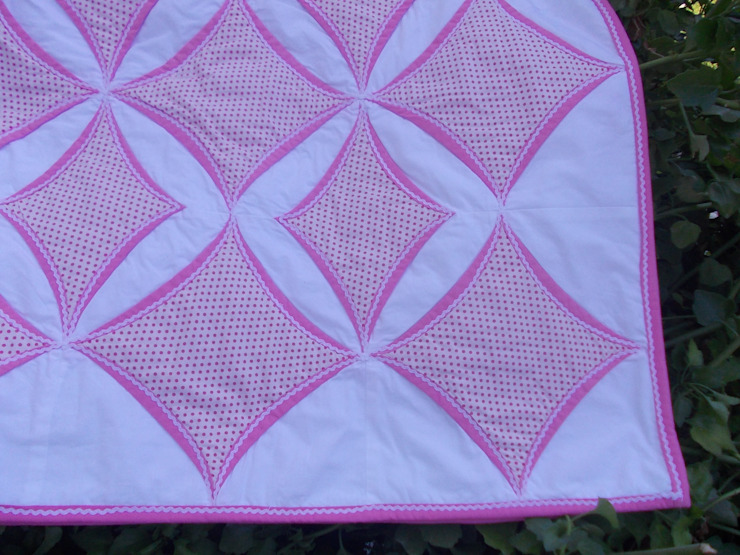 Detail of pink Cathedral window quilt: classic  by Lilliputquilts, Classic