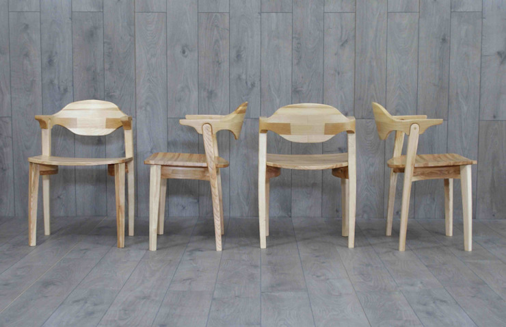 Valentine extending dining table and six chairs por Lee Sinclair Furniture Moderno