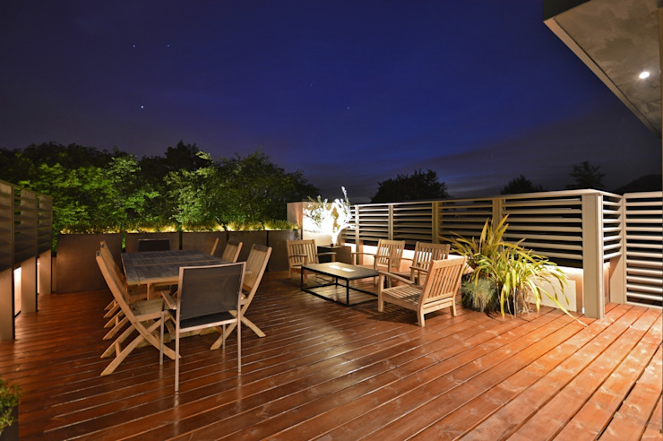 The roof terrace with fire pit table Modern balcony, veranda & terrace by Zodiac Design Modern