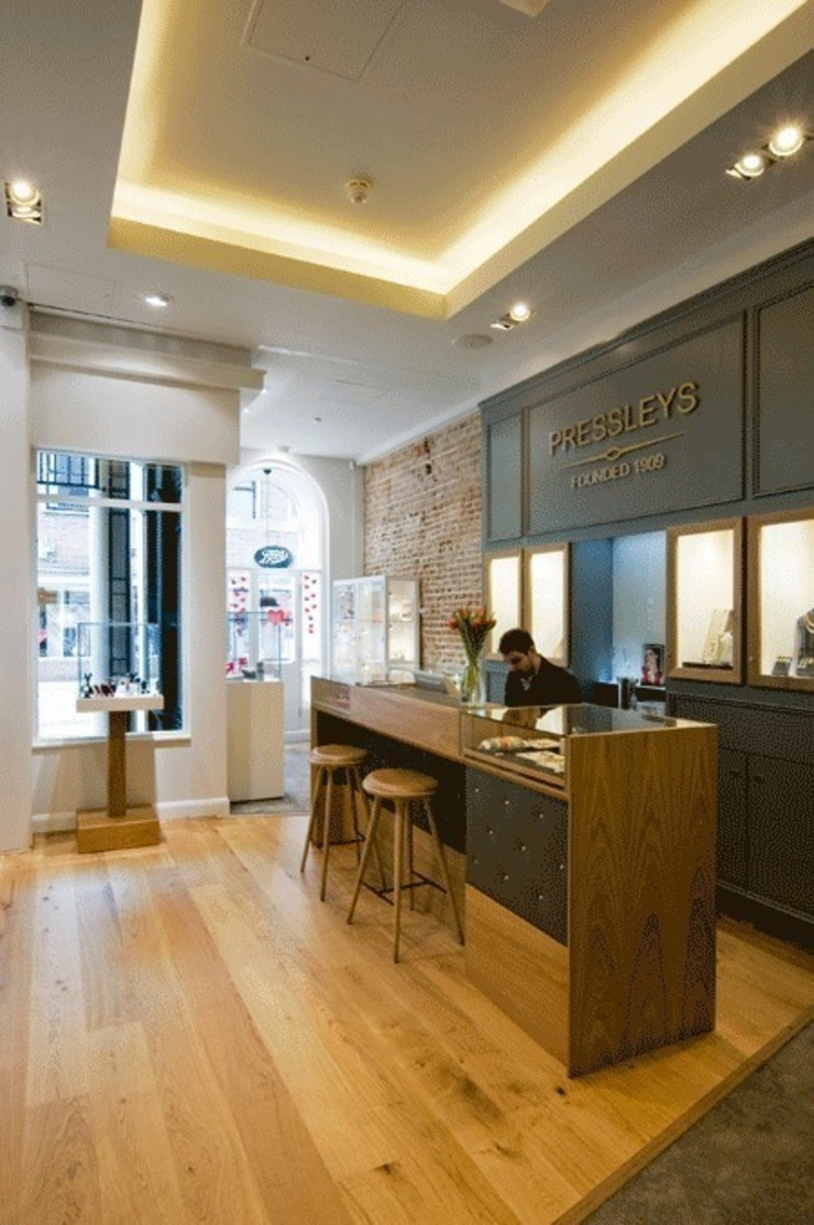 Main shop interior Modern commercial spaces by Engaging Interiors Limited Modern