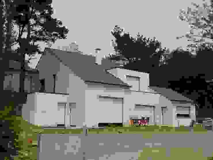 Casas modernas: Ideas, imágenes y decoración de Archimat Creation Moderno