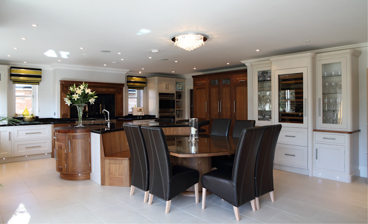 Walnut kitchen with bespoke table Modern kitchen by John Ladbury and Company Modern