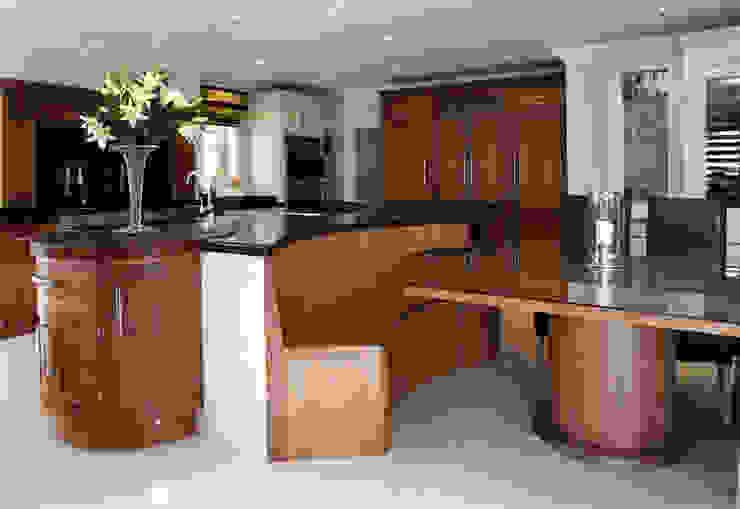 Beautiful walnut kitchen hand made Modern kitchen by John Ladbury and Company Modern