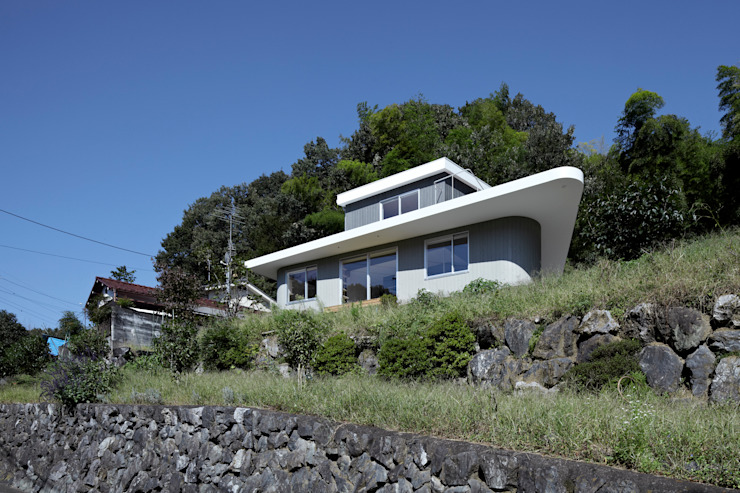 Eclectic style houses by 池田雪絵大野俊治 一級建築士事務所 Eclectic
