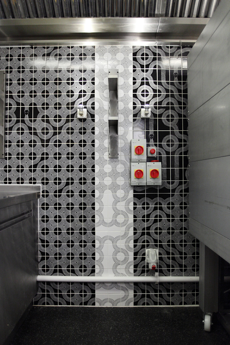 Ouroboros Tile installation at Canada Water Cafe, London Industrial style gastronomy by Peter Ibruegger Studio Industrial
