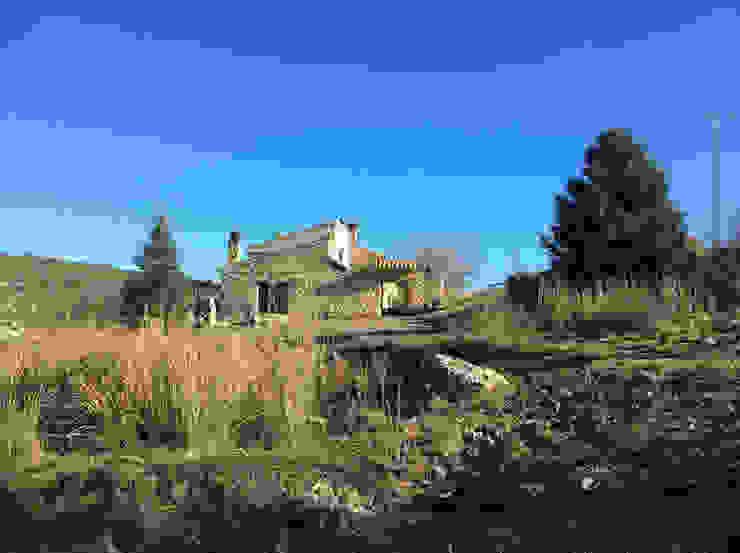 Fachada de piedra Casas de estilo rural de Anticuable.com Rural