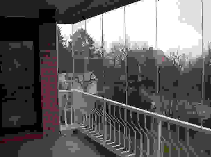 Zabudowa balkonu systemem bezramowym Klasyczny balkon, taras i weranda od SERVIKO Klasyczny