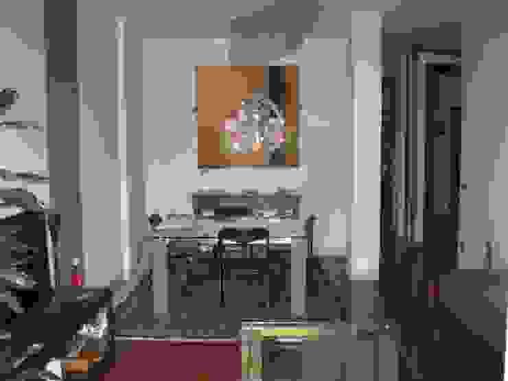 Ristrutturazione appartamento a Bergamo Sala da pranzo moderna di ARKHISTUDIO Moderno