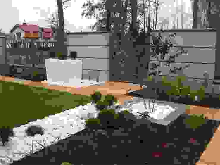 Ogród przydomowy z fontanną od Sungarden - Projektowanie i urządzanie ogrodów