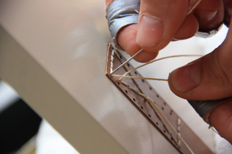 Stitching the handles by Tim van de Weerd